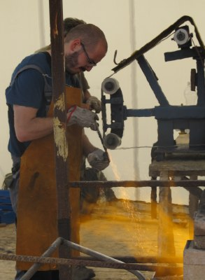 Treating Damascus steel at the Knife Festival in Maniago