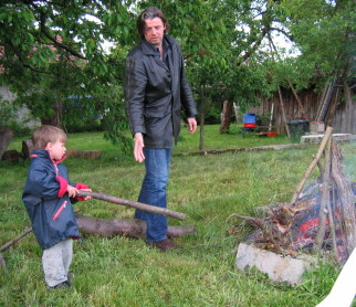 The neighbour's boys help to get the fire going.