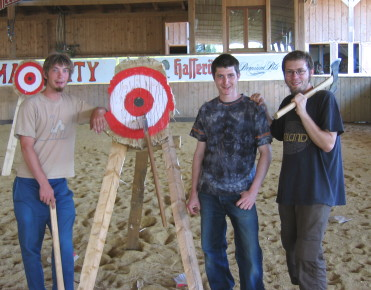 The three throwers from Switzerland with the remains of the target.