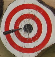 Spray painted EuroThrowers target, with Gyro Dart throwing knife sticking.